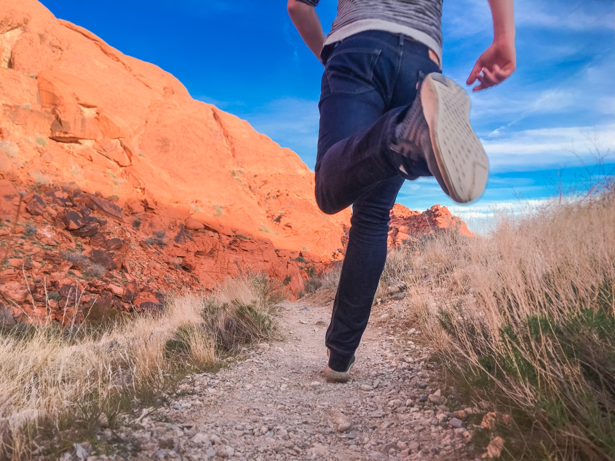 Man Running Outside Along Desert Trail.jpg